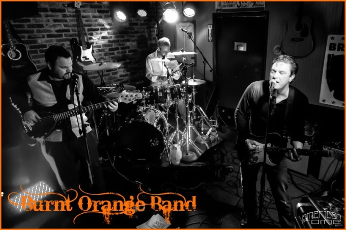 burnt orange band press photo